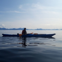 falt-water-kayaker-sillouette-Norway-in-background